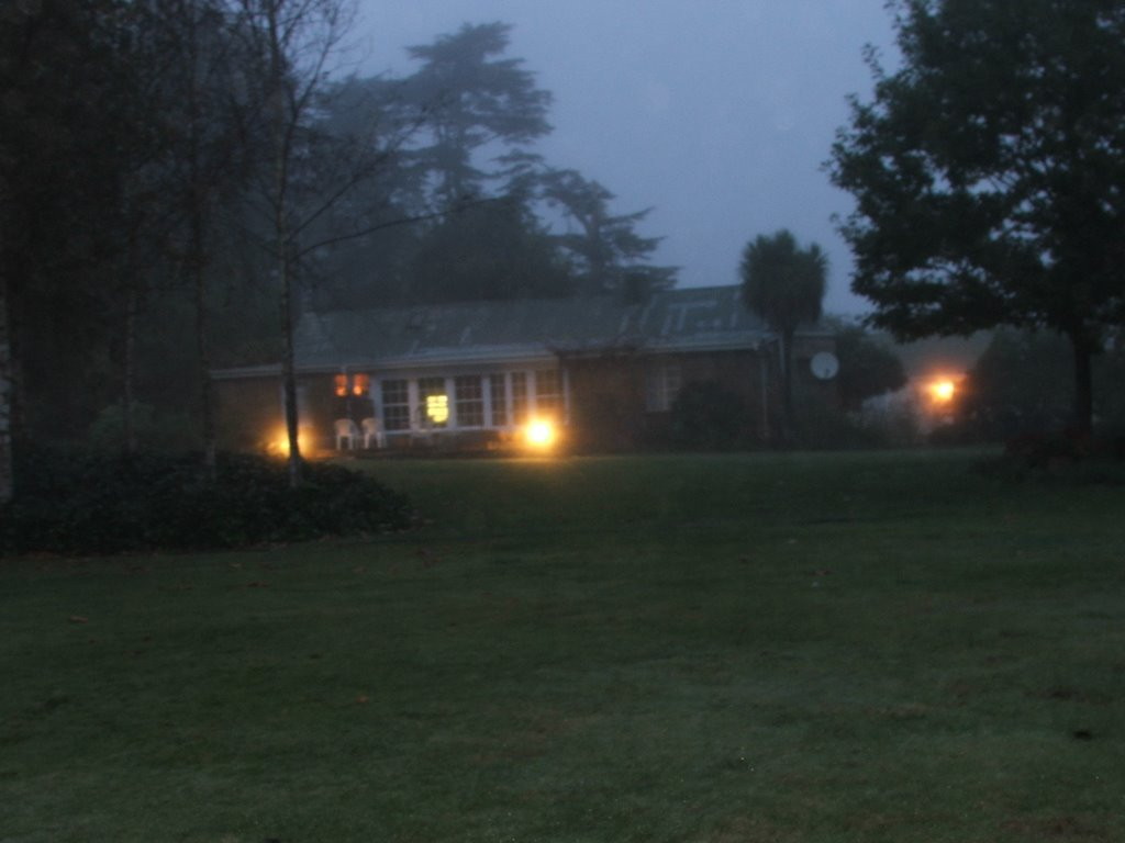Early morning mist shrouds the farmhouse