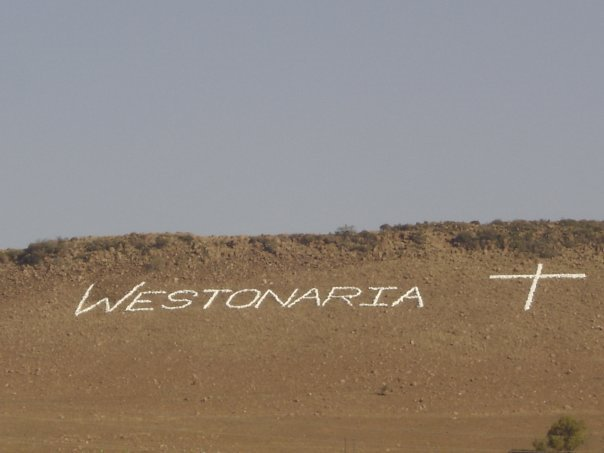 Westonaria made in stone on hill overlooking town.